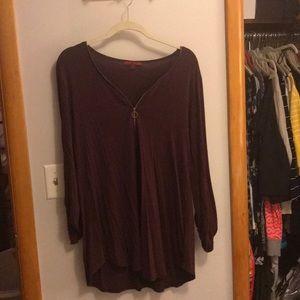 Mid sleeve Maroon shirt with zipper.
